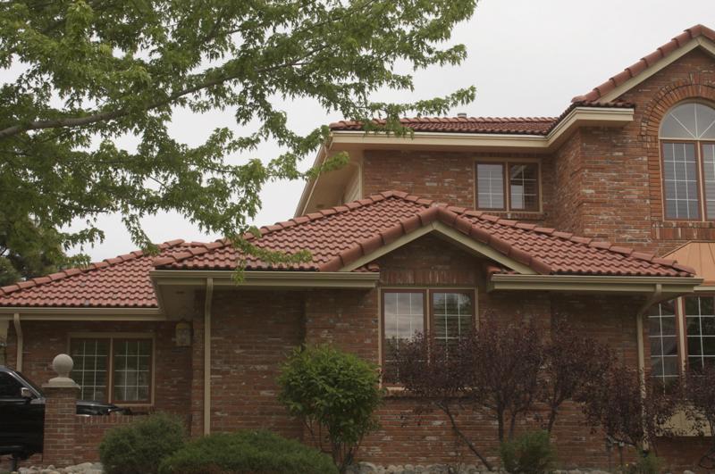Asphalt Shingles Roof on a Brich House