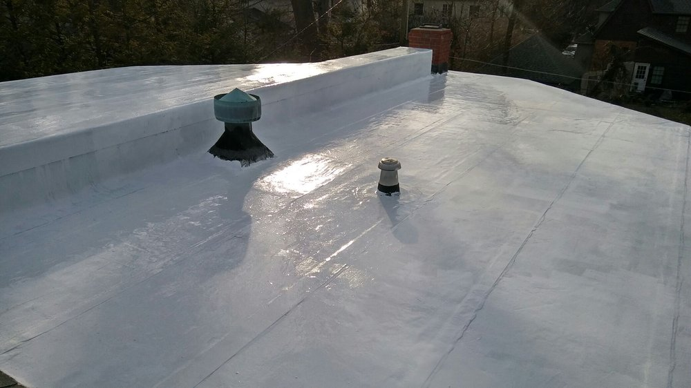 Cool roof coating on a flat roof