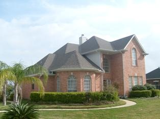 Asphalt Shingles Roof on a Brick House