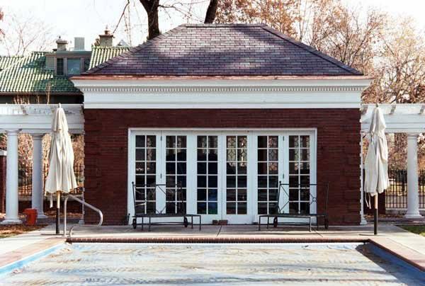 Asphalt Shingles Tile Roof on a Brich House