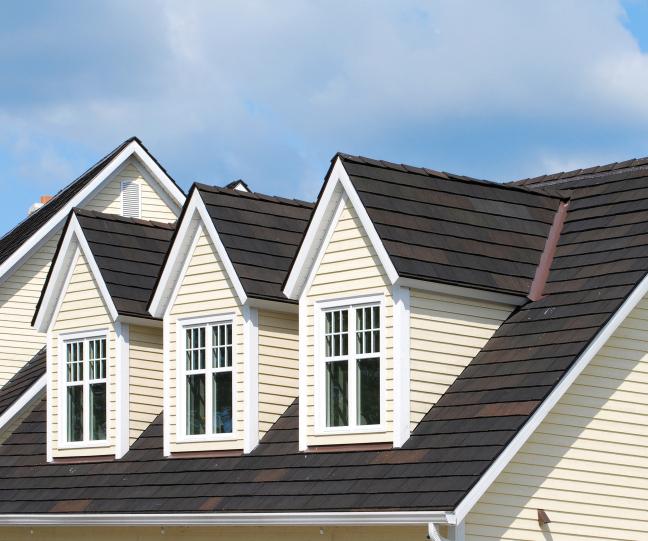 Shingles Tile Dormer Roof on a Wooden House