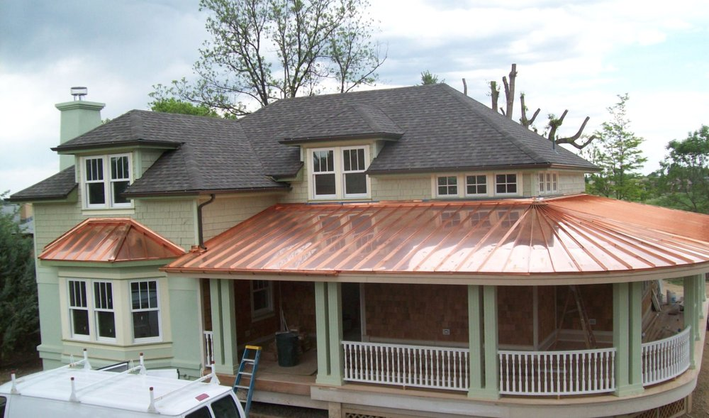 Asphalt Shingles with Copper Roof on a Wooden House