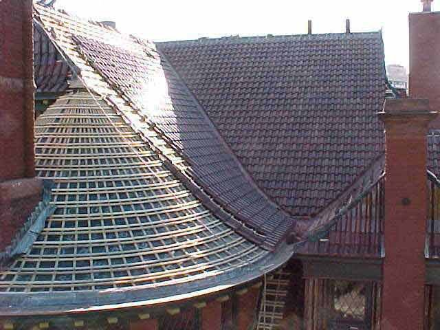 Asphalt Shingles with Metal  Roof on a Brick House